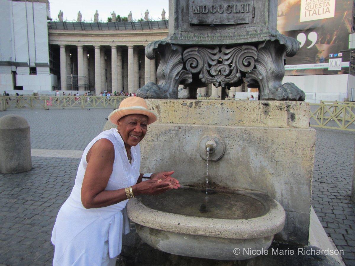 Alice splashing holy water