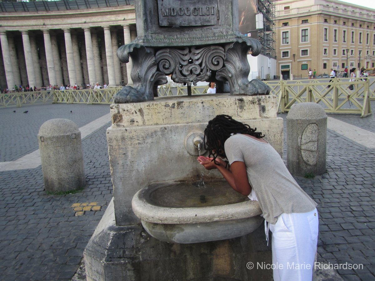 Me drinking holy water