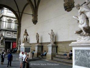 Inside the Loggia dei Lanzi at Piazza della Signoria