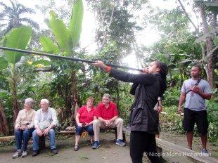 Nikki aiming the blow gun